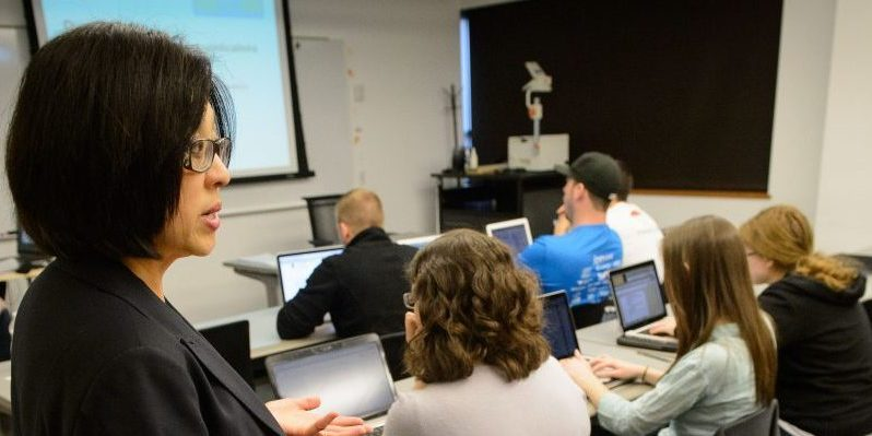 Fei Wang, associate clinical professor of pharmacy practice lectures at the Pharmacy/Biology Building on May 1, 2015. (Peter Morenus/UConn Photo)